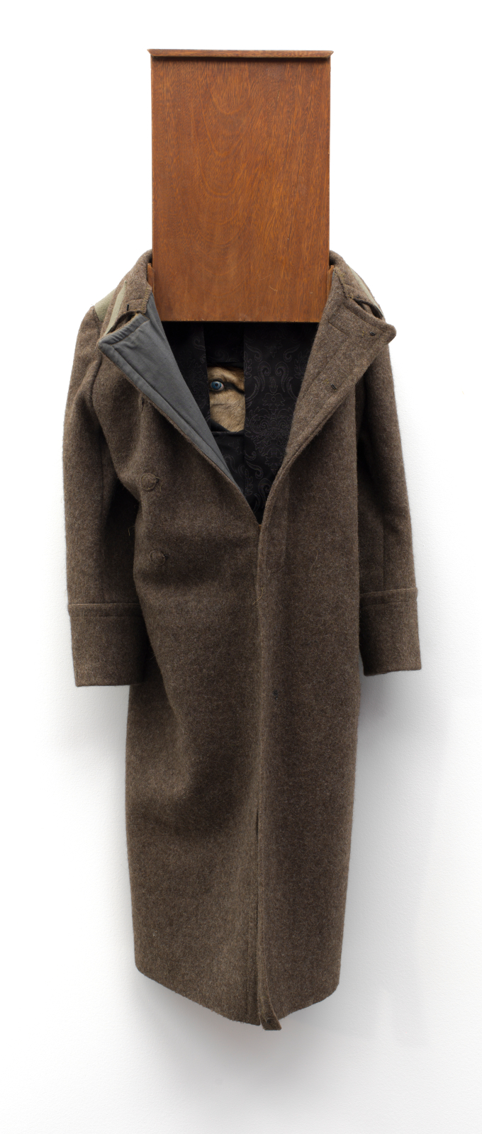 7dddf039b A long, brown wool trench coat is crowned by a panel of cherry wood in